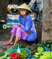 Vietnam Hoi An Market Women selling vegetables
